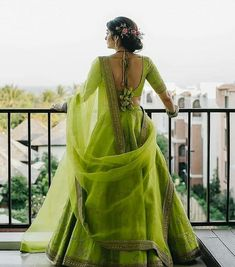 This parrot green lehenga is perfect Mehendi Outfits, Indian Bridal Outfits, Indian Designer Outfits, Bridal Dresses, Indian Lehenga, Green Lehenga, Lehenga Choli Designs, Designer Bridal Lehenga, Lehnga Dress