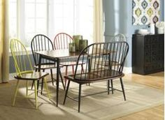 The Shanille dining collection brings the comfort and style of Vintage Casual design to your dining experience with the tubular metal base of the table in a black powder finish coat supporting a medium brown table top to create a beautiful two-toned collection. With the option of four different frame colors to the two-toned chairs, this dining collection adds a modern flair to this rustic furniture.