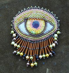 golden eye brooch/pin by suegoodebeads on Etsy, $54.00