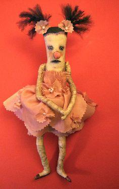 weird art doll dancer