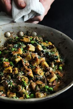 herb gnocchi with mid-season greens, mushrooms, and parmigiano cheese