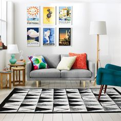 couch and side table placement / same style with travel prints behind