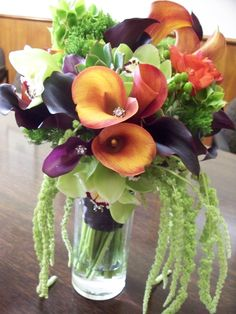 Black, orange, and purple calla lilies were the stars of this bouquet in fall colors.  www.ironheartimports.com