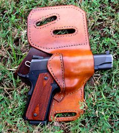 Custom concealed leather gun holster made for most gun models. $65.00, via Etsy.