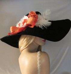 CORAL CHARM - Extra Wide Brim Black Floppy Picture Hat With Coral Roses & White Feather Accents.