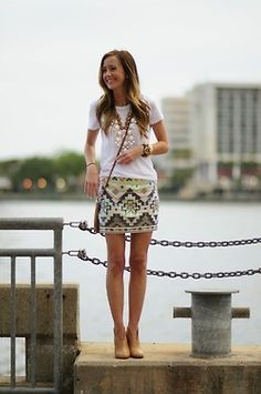 Tribal skirt with plain white tee shirt, white bubble necklace and a chestnut crossbody