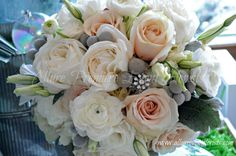Winter bride bouquet with Dusty Miller, Garden Roses and Ranunculus. A beautiful antique snowflake brooch adds a great touch!