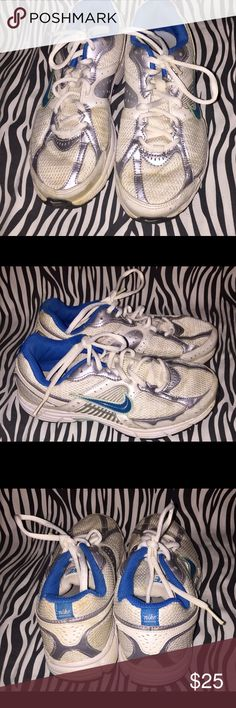 Nike Running Sneakers. Blue, White and Gray running shoes. Some signs of wear on shoes. Bottoms are in good condition. Shoes have been washed and disinfected. Nike Shoes Sneakers