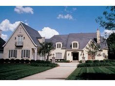 Eplans House Plan: With over 5,000 square feet to work with, this design uses it all with style  and finesse. From the two-story foyer, one can head to the cozy study on the  right or view the elegant formal dining room on th