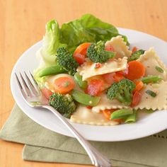 Use purchased Italian salad dressing and toss with ravioli, broccoli, carrots, and pea pods to make this salad. Other reduced-calorie dressings work also.