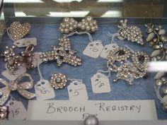 I have bridal brooch bouquet registries at the shop for that bride that wants her friends and family to bring a special brooch or earring set to the bridal shower.  That gift will help finish her bouquet!