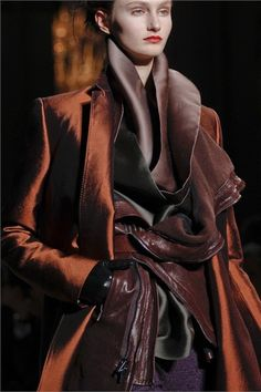 This combination of brown satin, rust coat ( also satin?), chocolate leather is great. Haider Ackermann 2012