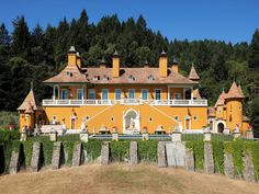 """occupying 43 acres in napa valley wine country, this seemingly vine-less estate was modeled after a """"bavarian hunting schloss"""" and certainly pays homage to deutschland, inside and out. rendered in a glaring orange color, the sprawling, 5,100-square-foot manse only manages to squeeze in three bedrooms, but includes nine fireplaces. for sale for $25000000."""