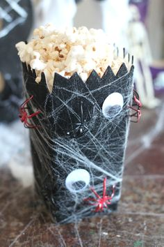 Take your standard paper popcorn box and add some spider webbing and creepy crawlies for this Halloween Spider Web Popcorn Box! #PopcornBoxParty2017