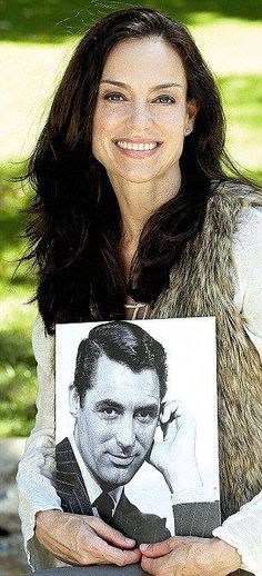 Jennifer Grant holding a picture of her father, Cary Grant.