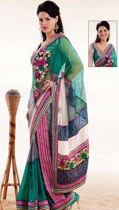 Attract all attentions with this embroidered saree.   This green, off white and grey net and faux georgette saree is nicely designed with embroidered patch work is done with resham, zari, stone and lace work.   Beautiful embroidery work on saree make attractive to impress all.   This saree gives you a modern and different look in fabulous style.   Matching blouse is available.   Slight color variations are possible due to differing screen and photograph resolution.