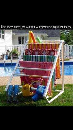 Outdoor towel rack...fill the bottom pic pipe with sand or water so that it doesn't move easily in the wind. May not store as nice as a folding clothesline...