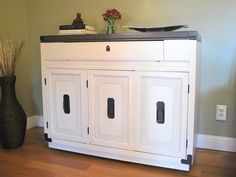 gray and cream refinished bar cabinet