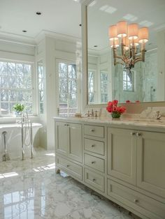 Waterworks fixtures, custom cabinetry, inlaid Marble floors & tub from Renaissance tile & Bath, and sconce from Circa Lighting.