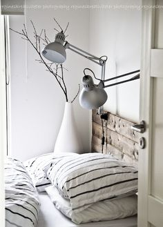 Bedroom | Wood Backboard, Lamps, and Black and White Striped Sheets | #anthropologie #pintowin