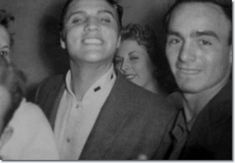 Elvis Presley with fans in an elevator after the show : April 15, 1956.
