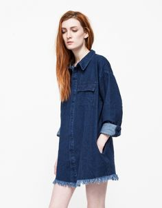 From Farrow, a long sleeve denim button-down shirt dress with modern details. Features a snap button-down front, two chest pockets, button cuffs, frayed hem, side pockets and a relaxed fit through the body.  •Long sleeve button-down shirt dress •Sn