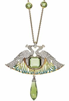 AN ART NOUVEAU PERIDOT, DIAMOND, ENAMEL AND GLASS PENDENT NECKLACE, BY RENÉ LALIQUE. The pendant modelled as two diamond-set peacocks facing each other, centering a rectangular cut-cornered peridot, to the enamelled feathers, suspending a briolette-cut green glass detachable pendant, the chain set with two single-cut peridots, 1897-1898, pendant 7.0 cm, chain 62.0 cm, with French assay marks for gold. Signed Lalique. #RenéLalique #ArtNouveau #Jewelry #Jewellery #BijouxArtNouveau