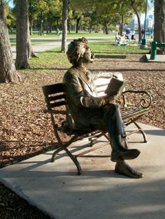 The Trinity Trails park area in Fort Worth includes this metal sculpture of Mark Twain sitting on a bench with a book in his hands. Fort Worth, TX. (Richard S. Buse photo)