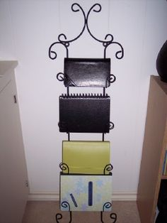Notebook Holder - i've seen the plate rack used for scrapbooks, but for some reason it never hit me to use it for notebooks, I have 4 that I currently work with and this would be a way to keep them handy and out of my purse!