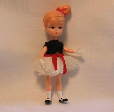 This is Cathy, the doll I got that came in her own little plastic hatbox. I loved her pretty little party dress. She was a 1965 Dolly Darlings Doll