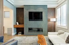 A rectangular fireplace with a tv inset. Chicago, IL Coldwell Banker Residential Brokerage