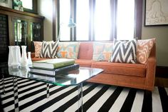 burnt orange couch goes wonderful with the bw rug!