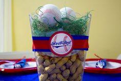 Baseball theme party centerpiece. Baseballs, nuts and grass centerpiece.