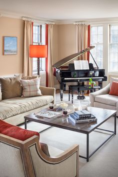 Photo credit: Irvin Serrano | transitional living room with piano | neutral living room with red and orange accents