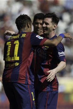 Neymar JR. (L) of FC Barcelona celebrates scoring their seventh goal with teammate Lionel Messi (R) during the La Liga match between Cordoba CF and Barcelona FC at El Arcangel stadium on May 2, 2015 in Cordoba, Spain.