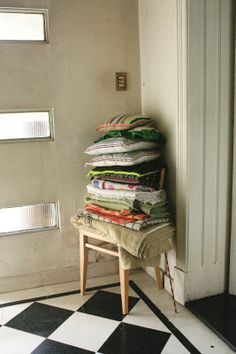 Pillows and blankets stacked on a chair.