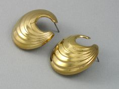 Lovely polished gold tone Avon, c. 1992, called 'Sculptured Button'. Earrings #Avon #DropButton