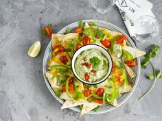 Grab your sombrero and make these fab nachos & avocado dip with Alpro Simply Plain Big Pot! Your guests will love this delicious appetizer!  Meal of the day: snack - appetizer.  Ingredients: Coriander - lemon - Alpro Simly Plain - Avocados - chilli - nachos - tortilla wraps - cherry tomatoes. Suited for: lactose-free - vegan - vegetarian.  Season: summer.