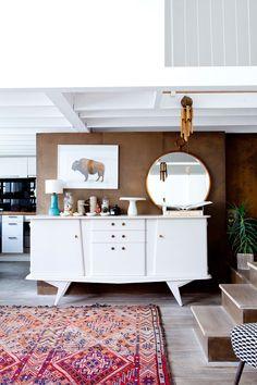 Cécile Figuette's home in Paris-white painted vintage credenza is an interesting idea