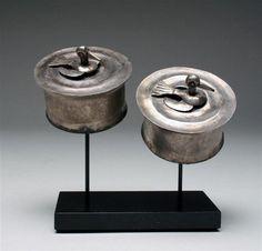 A Pair of Sican Silver Royal Ear Spools - Birds, Peru, ca. 800 CE