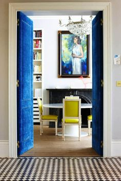 blue upholstered doors with nailhead trim