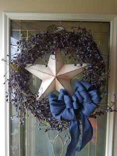 Grapevine wreath with star!  $45. Let me create one for you. Theresa Creations on Facebook