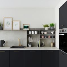 Achieve a modern industrial look with our Greenwich Super Matt Charcoal kitchen. Contrast the dark cabinets with warm brass handles and concrete-effect doors to add urban accents to your space.