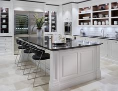 This luxury grey painted kitchen features a statement island perfect for any gathering, complete with the latest in Wolf appliances. Grey Painted Kitchen, Modern Grey Kitchen, Classic White Kitchen, Contemporary Kitchens, Modern Kitchens, Kitchen White, Beautiful Kitchen Designs, Best Kitchen Designs, Beautiful Kitchens
