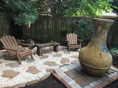 Backyard patio with painted concrete bench, chiminea, adirondack chairs
