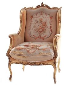 Louis XV style carved giltwood wing chair...