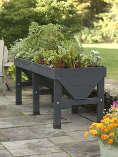 I wish I were more handy with DIY. I'd make one of these. VegTrug Patio Garden Charcoal | Convenient Elevated Raised Bed