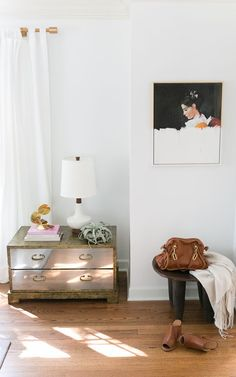 Decorist DesignOff with Jojotastic. Interior styling details. Sarreid style brass chest and white Caravan Pacific lamp. Glam mixed with boho African handmade wooden stool.