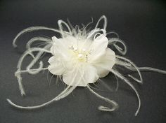 Ivory Rose Silk Bridal Hair Accessory Fascinator pearl Swarovski Luxury Light Ivory Rose Silk Bridal Hair Accessory Fascinator with Freshwater Pearls and Swarovski Crystals Fragile in nature, Floreti couture silk Mermaid Rose is jewelry. Mermaid Rose bridal hair clip, fascinator custom-made of light ivory silk. Adorned with white freshwater pearls, tiny crystals on silver wire, and delicate ivory feather accents. Dimensions: Rose bloom is about 2-1/2 inches in diameter.
