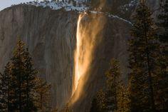 Sunset lights up Horsetail Falls on the large granite face of El Capitan in Yosemite National Park, Calif